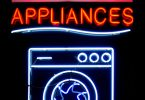 "Neon Sign of the word ""Appliances"" with a neon washing machine unerneath"