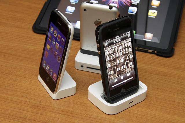 Three iPhones in their docks